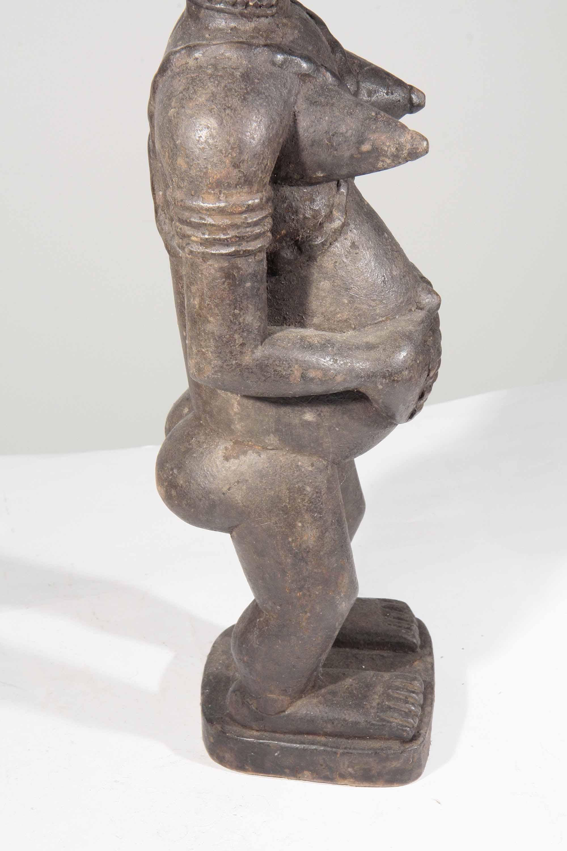 statue africaine femme enceinte